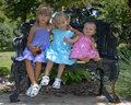 Three Sisters On Bench Royalty Free Stock Photos - 2797228
