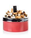 Cigarettes And Old Ashtray Stock Photography - 27909922