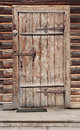 Door In Wall Of An Old Log House Stock Images - 27924284