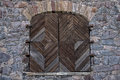 Wooden Door In A Stone Wall Royalty Free Stock Image - 27931416