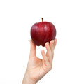 Hand Holding A Red Apple Stock Photo - 27941610