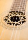 Closeup Of Strings On Old Acoustic Guitar Stock Photography - 27945462