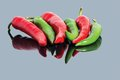 Red And Green Hot Chili Peppers Background Stock Photos - 27962373