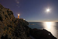 Lighthouse On Top Of Cliffs With Night Sky Stock Photos - 27962823