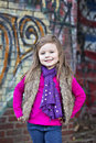 Cute Little Girl In Front Of Graffiti Stock Image - 27968401