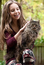 Girl And Her Cat Royalty Free Stock Photo - 27975975