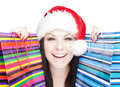 Christmas Woman Holding Shopping Bags Over Whit Royalty Free Stock Images - 27977659