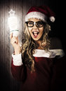 Smart Female Santa Claus With Christmas Idea Royalty Free Stock Photography - 27982597