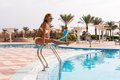 Cheerful Slim Woman On Pool Rails Stock Image - 27985471