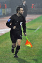 Referee Running Along The Field Royalty Free Stock Photography - 27997807