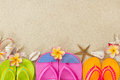 Flip Flops In The Sand With Shells And Frangipani Royalty Free Stock Photo - 28007965