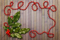 Garland And Holly Leaves Royalty Free Stock Images - 28008629