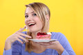 Young Woman Eating Cake Stock Image - 28009271