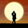 Romantic Couple Silhouette Kiss By Sunset Royalty Free Stock Images - 28016439