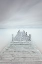 Wooden Pier On Lake In A Cloudy And Foggy Mood. Stock Photo - 28017360