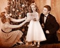 Family With Children  Dressing Christmas Tree. Stock Images - 28031654