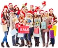 Girl In Santa Hat Holding Christmas Gift Box. Royalty Free Stock Images - 28031709