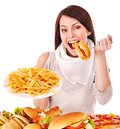 Woman Eating Fast Food. Stock Photos - 28031743