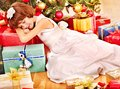 Child With Gift Box Near Christmas Tree. Royalty Free Stock Photography - 28031877