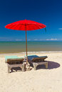 Red Parasol With Deckchair On Tropical Beach Stock Image - 28048111