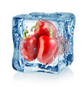 Ice Cube And Red Peppers Stock Photos - 28050143