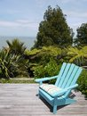 Garden: Blue Chair On Wooden Deck Royalty Free Stock Image - 28056886