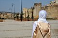 Moroccan Woman In Golden Djellaba And White Hijab Royalty Free Stock Image - 28089936