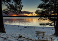 Mountain Lake Sunset With Picnic Table Royalty Free Stock Photo - 28113535