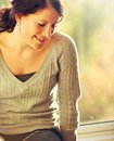 Woman Looking Down And Thinking Happy Thoughts Royalty Free Stock Images - 28122529