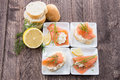Salmon Starters On Small Plates Royalty Free Stock Photo - 28122945