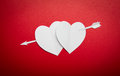 Two Paper Hearts Pierced With An Arrow Symbol For Valentines Day Stock Photos - 28147513