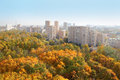 High-rise Buildings And Yellow Trees In Park Stock Photos - 28153423