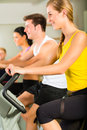 People In Sport Gym On The Fitness Machine Stock Photo - 28155970