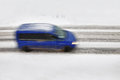 Vehicle Driving On The Snowy Road Royalty Free Stock Image - 28169356