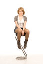 Young Blonde Girl Sitting On A Bar Stool Royalty Free Stock Photography - 28180137