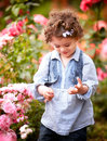 Baby Girl In Rose Garden Royalty Free Stock Photography - 28202147