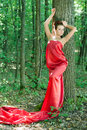 Young Beautiful Woman In Red Dress In Green Woods Stock Photography - 28209082