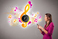 Pretty Girl Singing And Listening To Music With Musical Notes Stock Photo - 28249230
