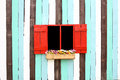 Red Windows And Decorative Colorful Wood Wall Stock Photo - 28252370
