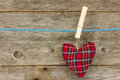 Heart Hang  Over A Wooden Background Royalty Free Stock Images - 28263429
