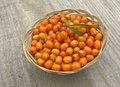 Ripe Sea Buckthorn In Basket On Wooden Background Royalty Free Stock Photography - 28267257