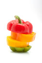 Slices Of Red, Green, Yellow And Orange Pepper Isolated On White Background Royalty Free Stock Image - 28275526