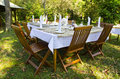 Dining Table Set In Lush Garden Royalty Free Stock Image - 28281326
