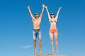 Young Couple Jumping Together Royalty Free Stock Images - 28291369