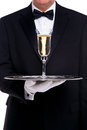 Butler Serving A Glass Of Champagne Royalty Free Stock Photo - 28305835