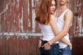 Emotive Portrait Of A Stylish Couple In Jeans Standing Together Stock Images - 28306554