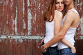 Emotive Portrait Of A Stylish Couple In Jeans Standing Together Royalty Free Stock Photo - 28306555