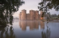 Stunning Moat And Castle In Autumn Fall Sunrise With Mist Over M Royalty Free Stock Image - 28317046