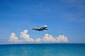 Airplane Above Sea Stock Image - 28319451