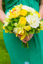 Bridesmaid And Bouquet Royalty Free Stock Photo - 28330105
